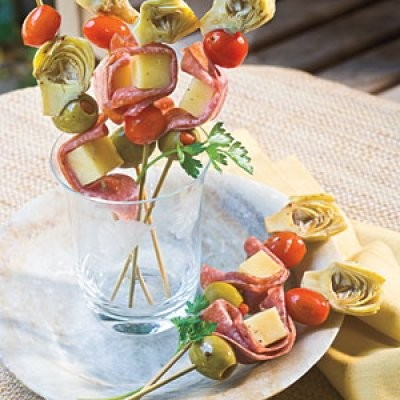 Italian Style skewers with cheese, salami, olives, tomatoes and artichoke